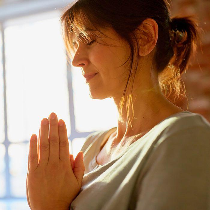 close up of yogi woman meditating at yoga studio
