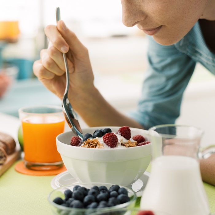 Woman having an healthy delicious breakfast at home