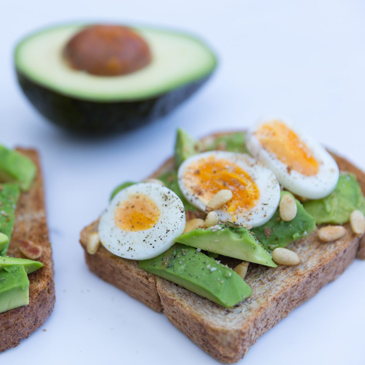 Healthy eggs and avocado on toasted bread