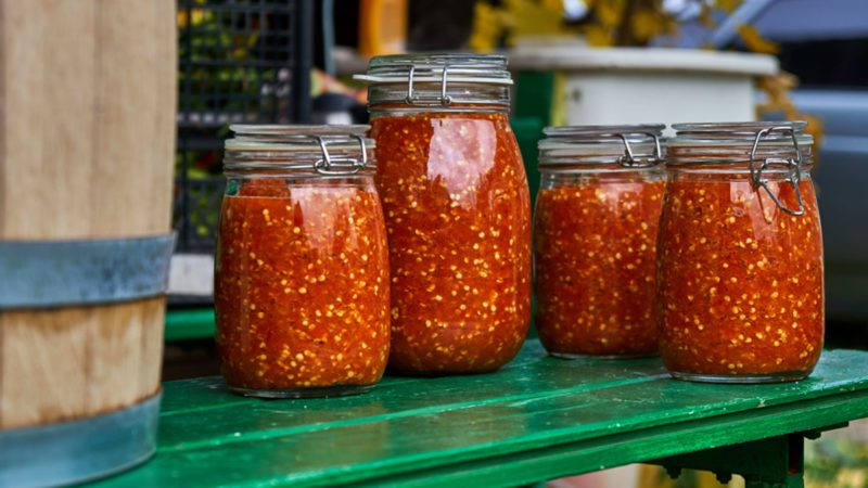 Grinded hot pepper in jars