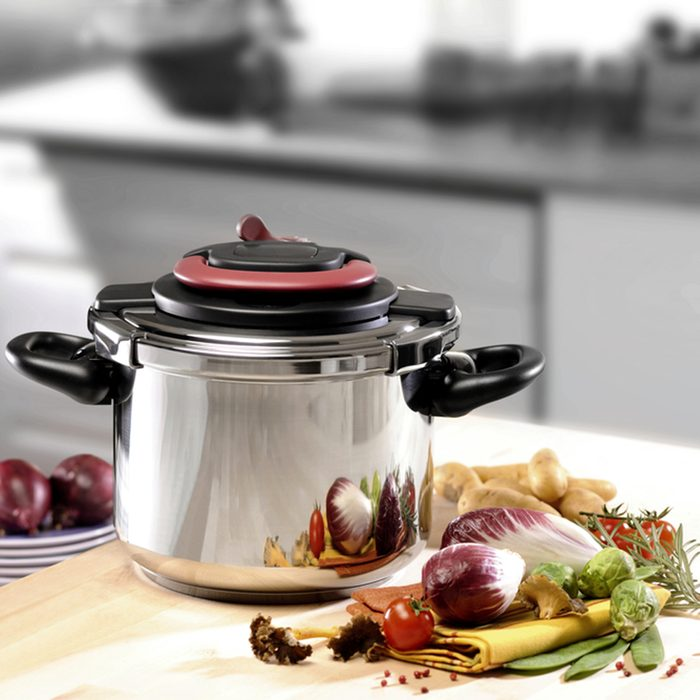 stainless pressure cooker on kitchen