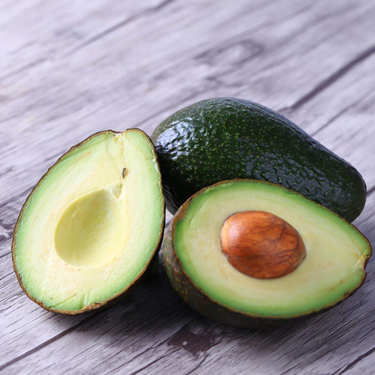Fresh avocado on a wooden table