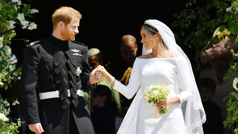 Prince Harry and Meghan Markle stand on the steps of St. George's Chapel in Windsor Castle in Windsor, near London, England, as they leave after their wedding ceremony