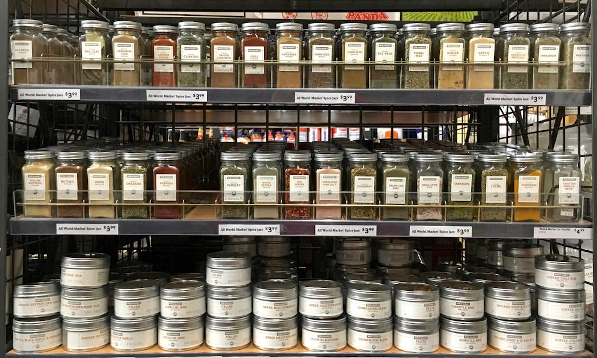 Grocery store shelf with jars of herbs and spices. Fresh herbs and spices can take a dish from good to great