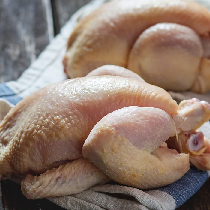 Two Raw mini Chicken on kitchen towel over old wooden table. Dark rustic style. Natural day light.; Shutterstock ID 340672502; Job (TFH, TOH, RD, BNB, CWM, CM): Taste of Home