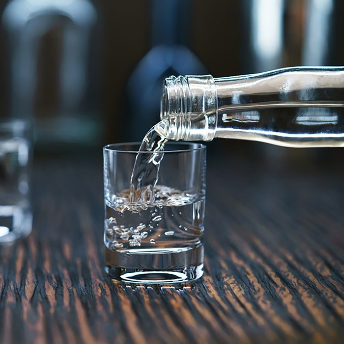 2 Russian vodka pouring from the bottle into glass in a bar, selective focus; Shutterstock ID 569664118; Job (TFH, TOH, RD, BNB, CWM, CM): Taste of Home