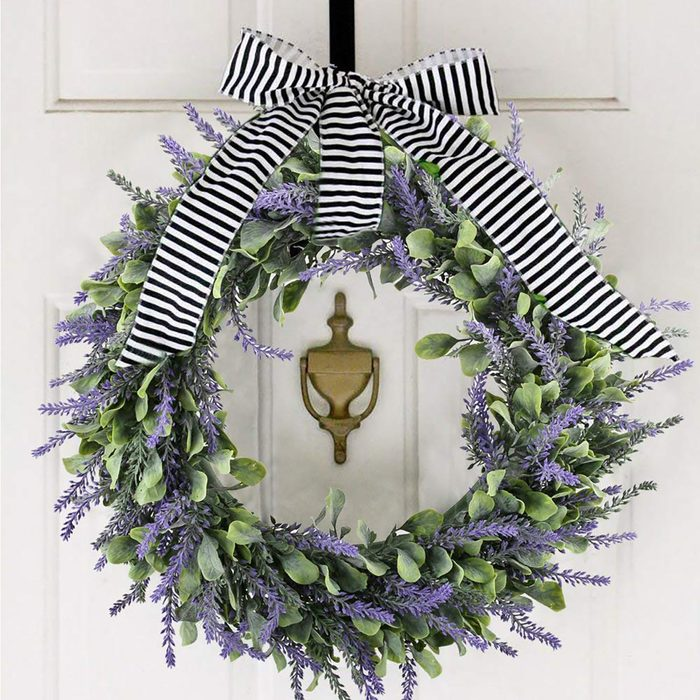 lilac wreath with black and white bow on door
