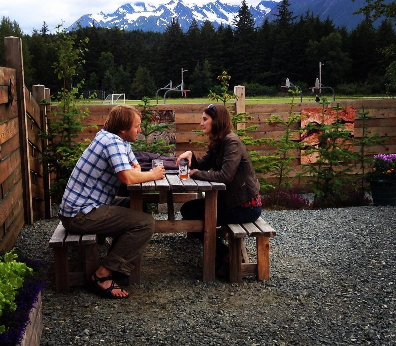 Two people sitting together at Haines Brewing's beer garden