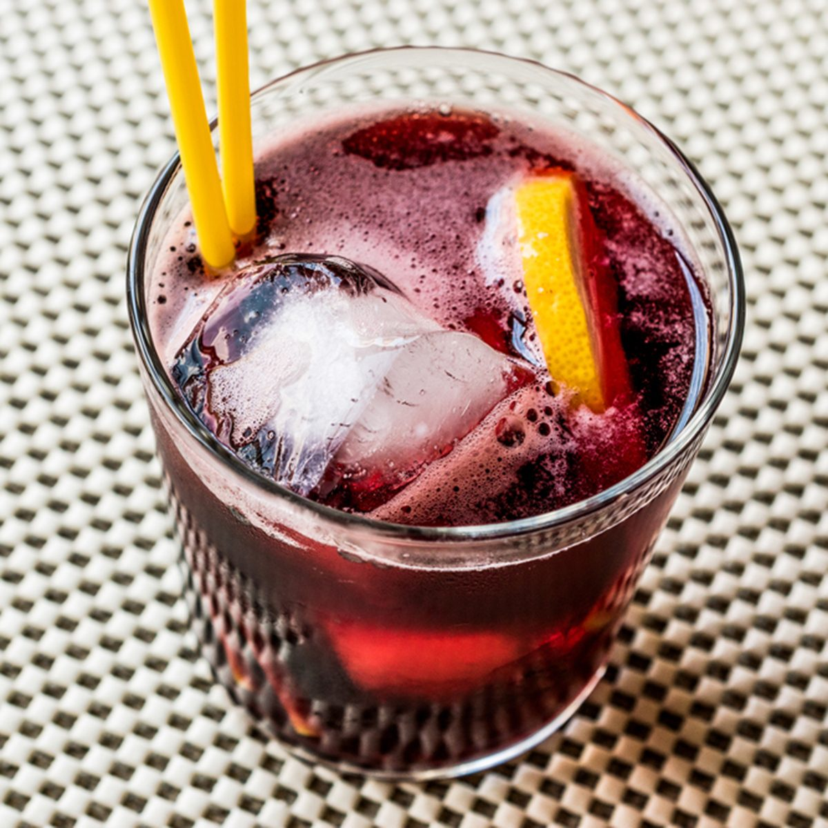 Americano Cocktail with lemon and ice.
