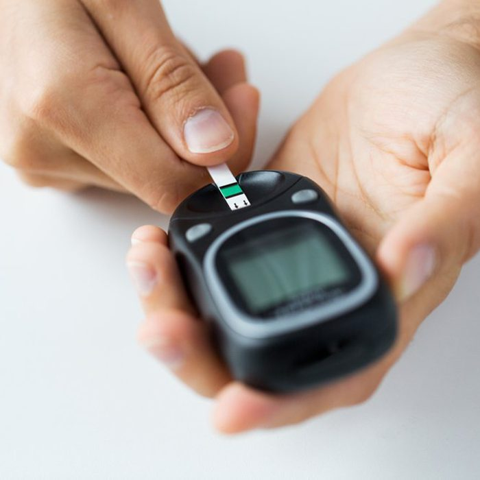 Person checking their blood in a handheld device