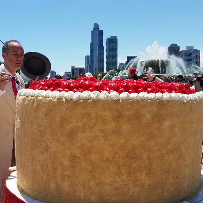 Huge cheesecake against a city back drop