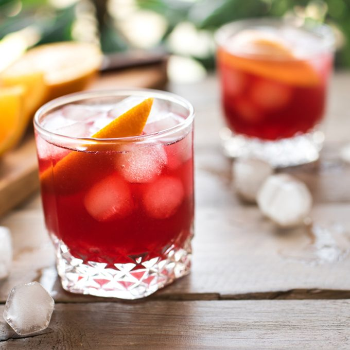 Negroni Cocktail with orange and ice.