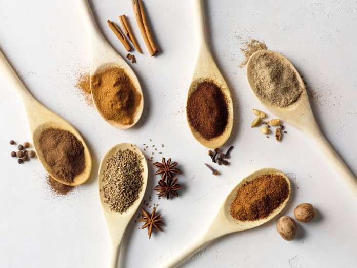 Spoonfuls of allspice, star anise, cinnamon, cloves, nutmeg, cardamom