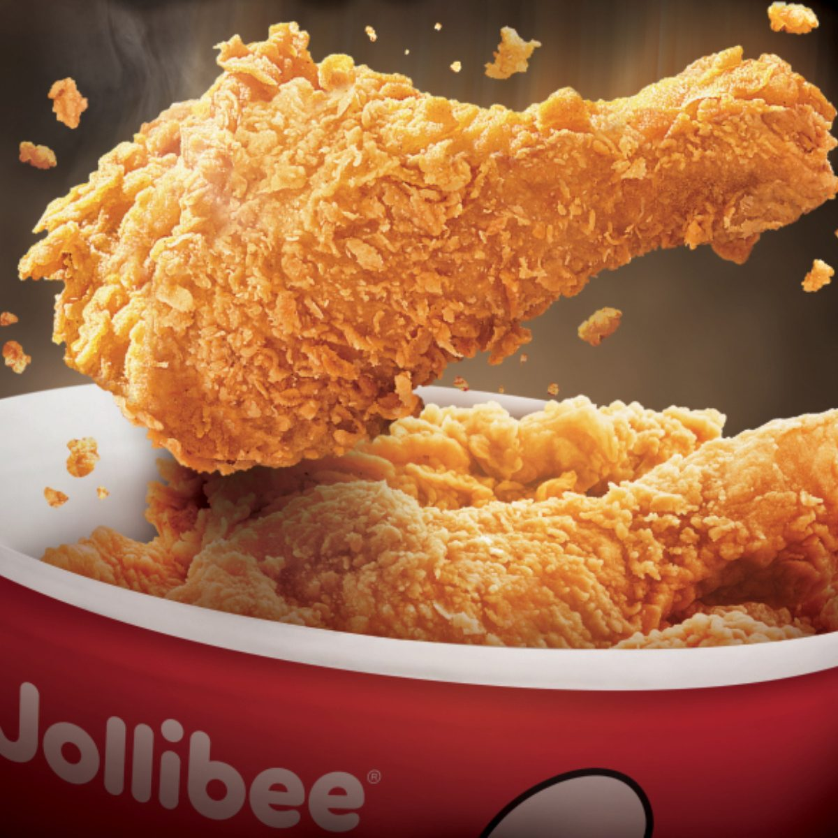 Fried chicken falling into a bucket