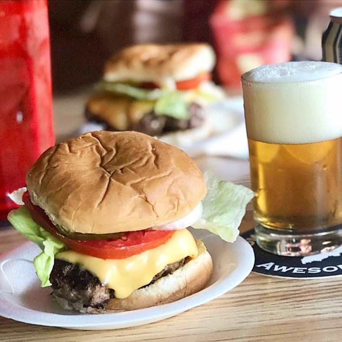 Close-up of a burger and beer at The Red Key Tavern