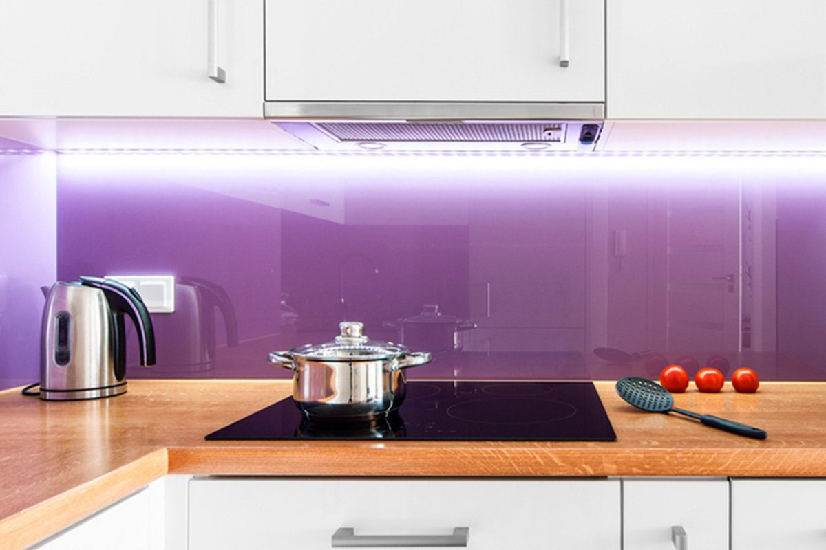 Kitchen with large glass panel instead of tile
