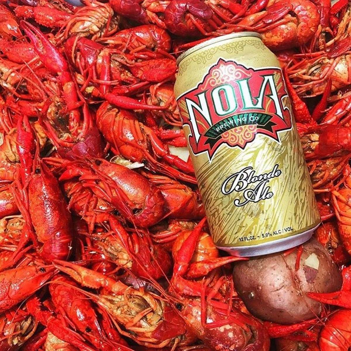 Crawfish background with a can of Nola
