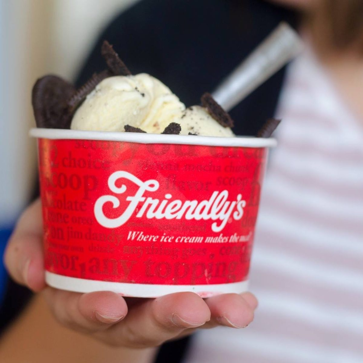 Friendly's ice cream in hand