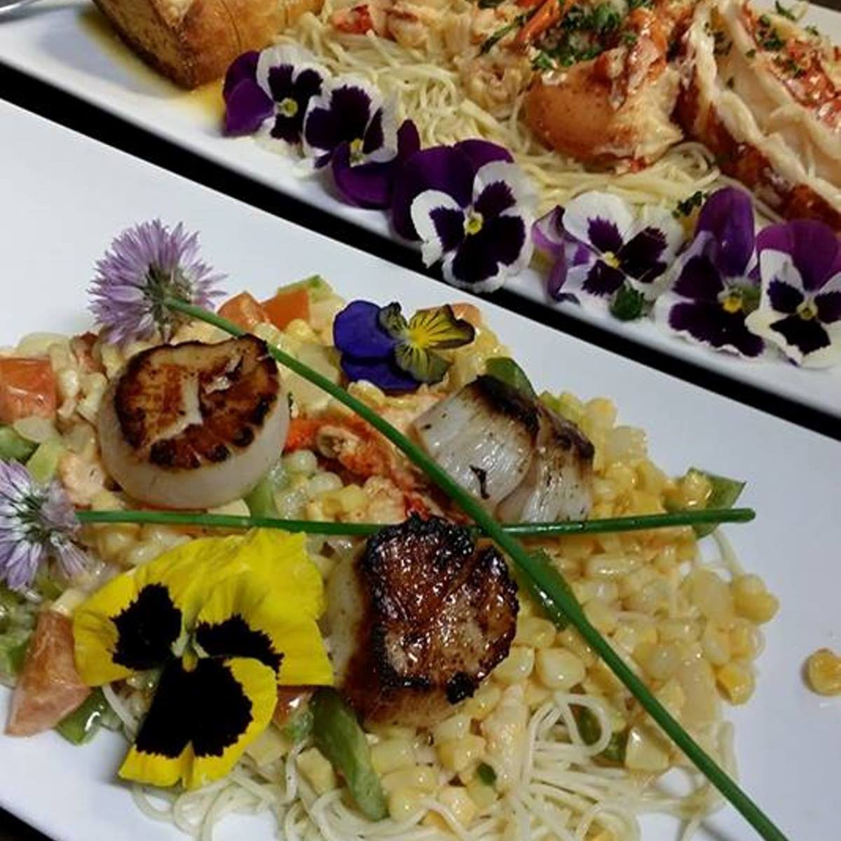 Plates of seafood decorated with flowers at Ebenezer's Pub