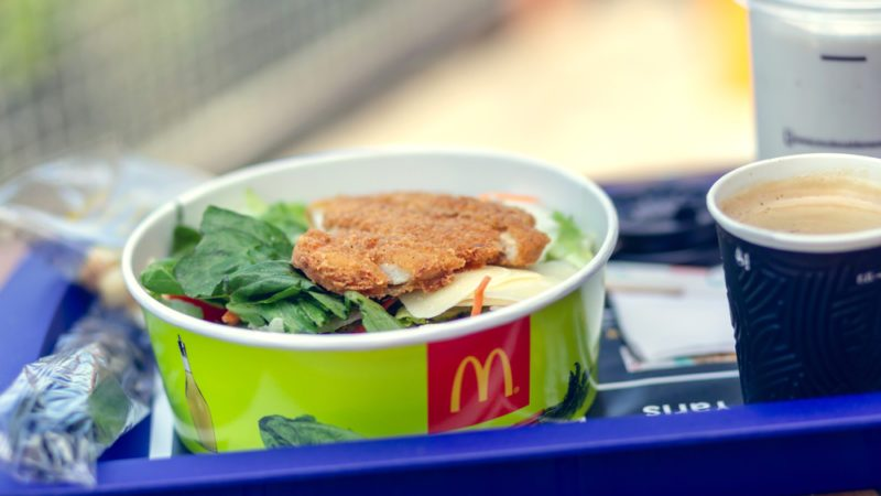 Famous McDonald's restaurant, Poland - Nowy Sacz - July 4, 2018. Set of food on a tray at a Mcdonalds restaurant. Salad, shake and coffee. Shallow depth of field.; Shutterstock ID 1129537418; Job (TFH, TOH, RD, BNB, CWM, CM): TOH McDonalds Salad Outbreak