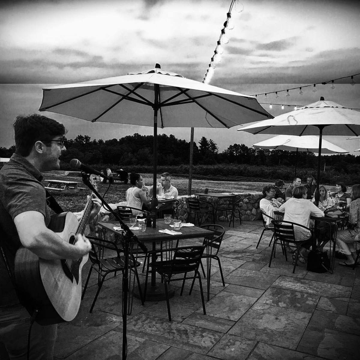 Black and white photo of live music playing at Apprecrest Farm Bistro