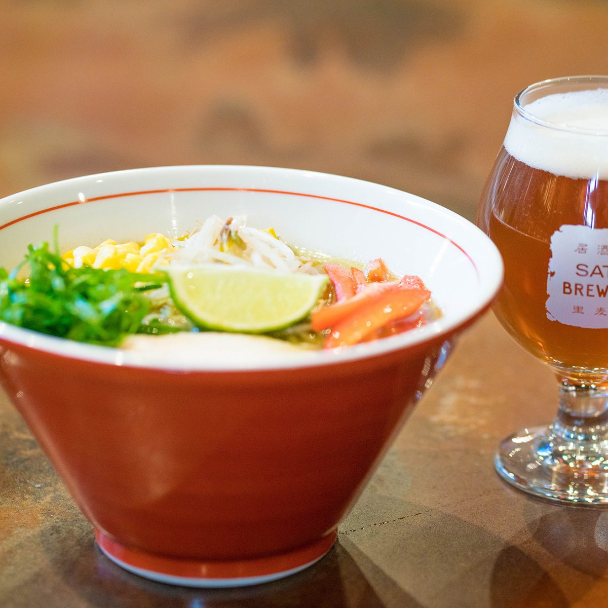 Close-up of Green Curry Ramen with Rabbit in the Moon ale at Sato Brewpub