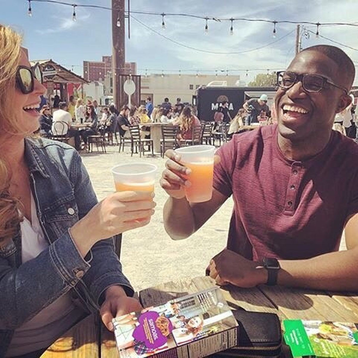 Woman and man enjoying beers together at Bleu Garten