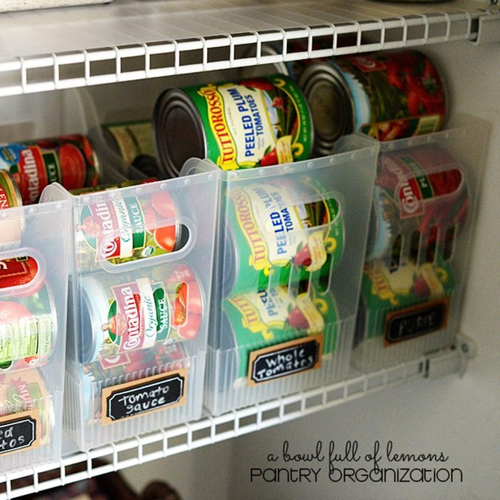 Cans organized in plastic containers