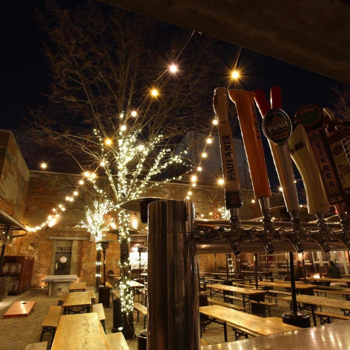 Frankford Hall's beer garden lit up at night