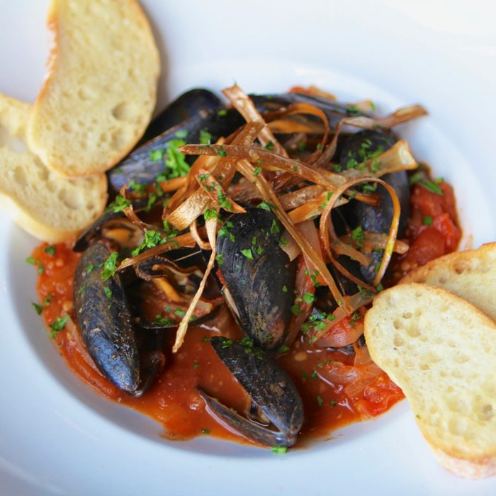 Close-up of mussels in sauce at La Cabra Brewing