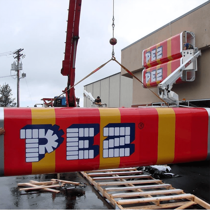 Huge signs shaped like pez candy