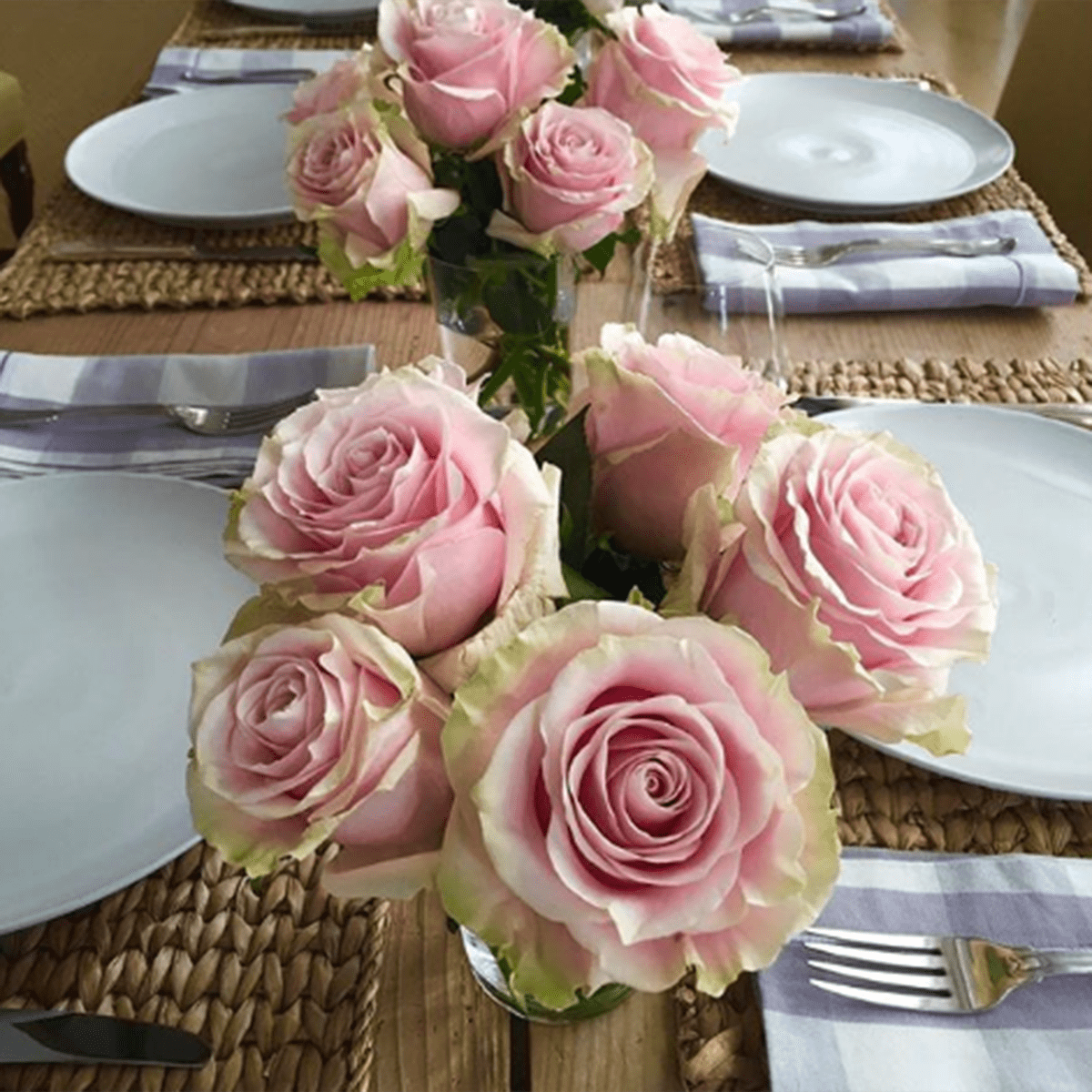 Table with rose centerpieces