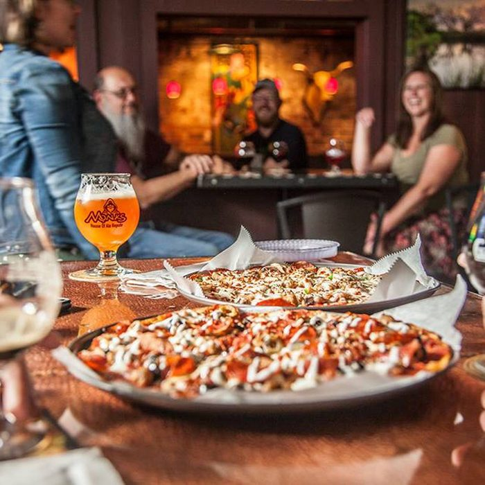 Close-up of pizza and beer at Monk's House