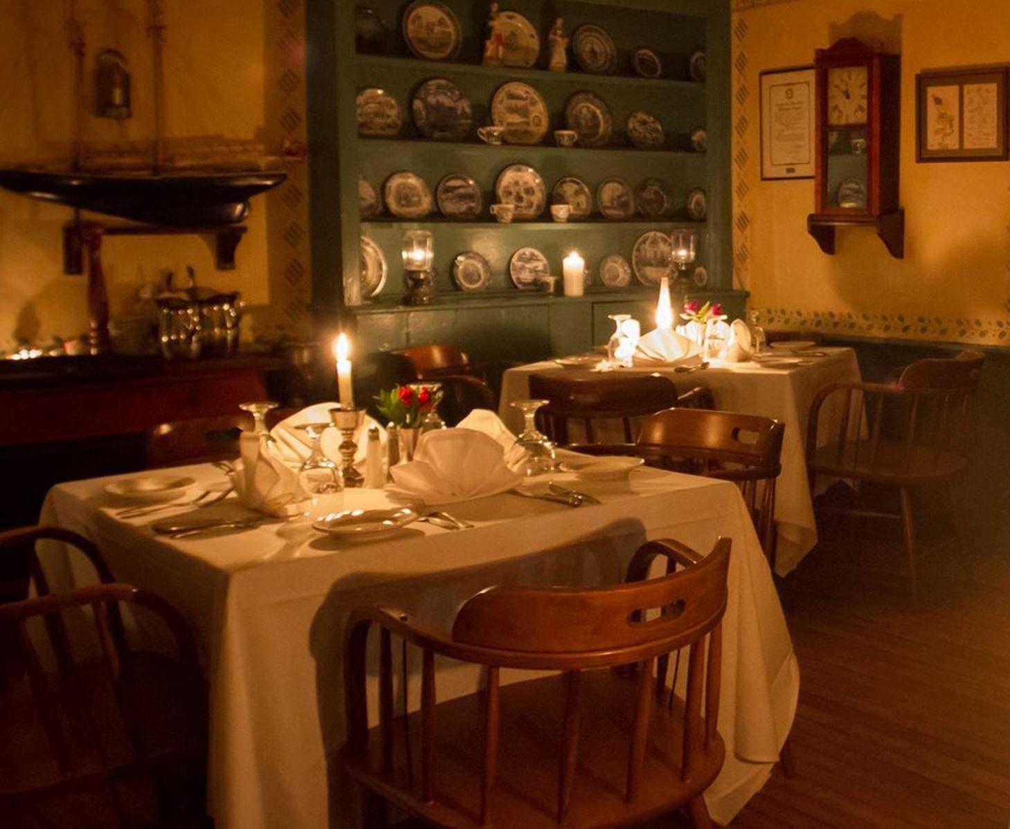 Romantic dinner setting inside Ye Olde Tavern