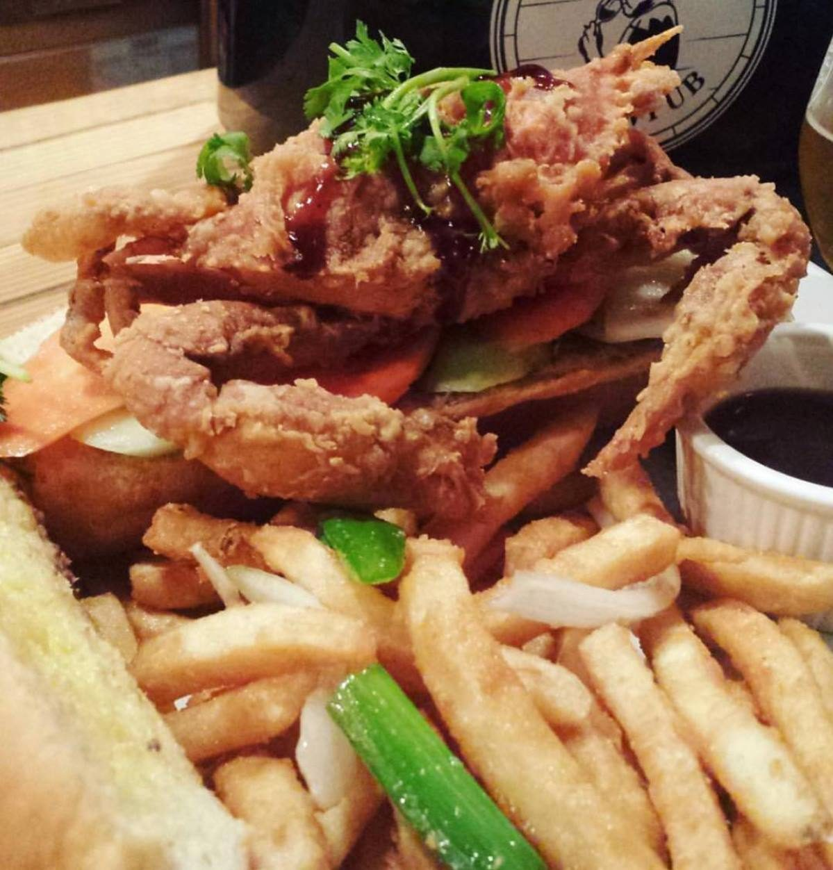 Close-up of fried crab and fries at The Answer