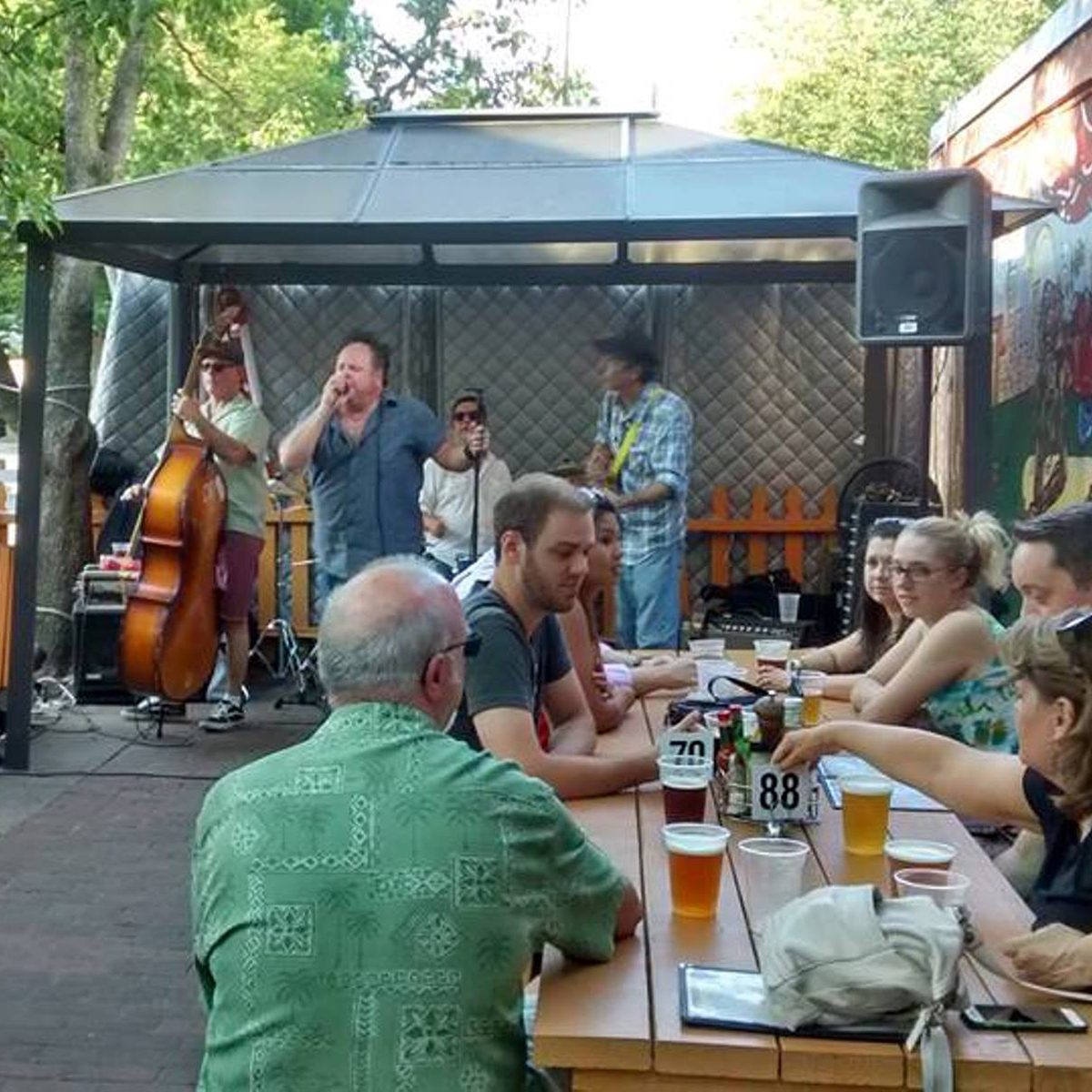 People enjoying live music and drinks at Westover Market's beer garden
