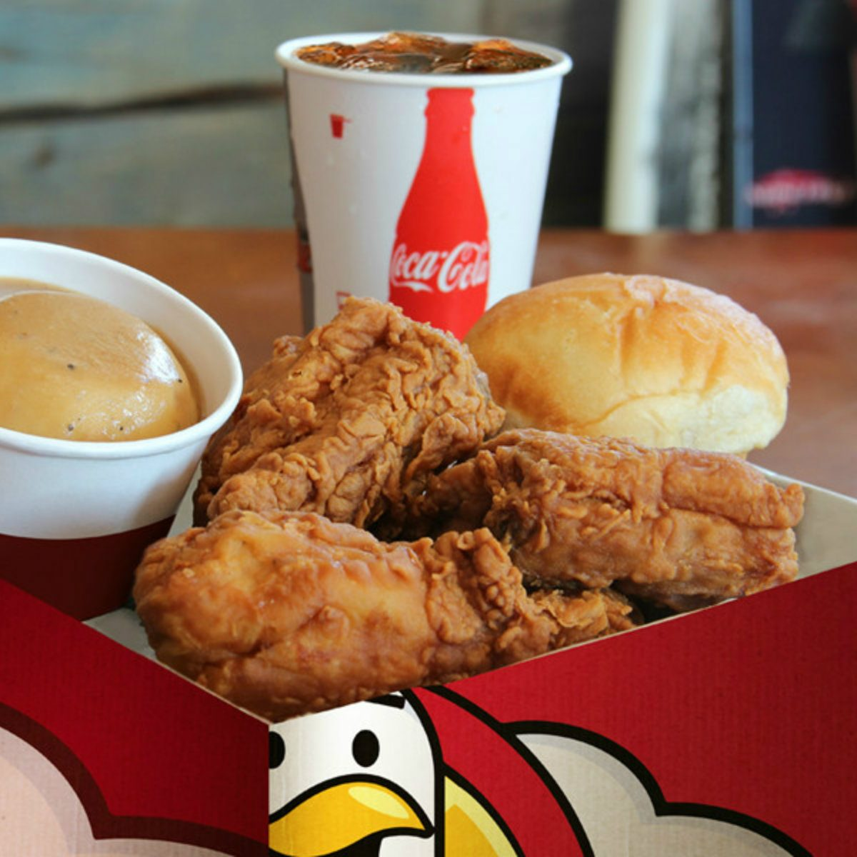 Heaven Sent Fried Chicken with a roll, sauce and drink