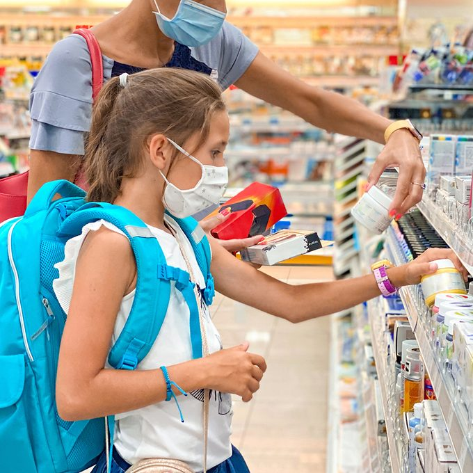 Mother and Daughter on Back To School Shopping During Coronavirus Pandemic