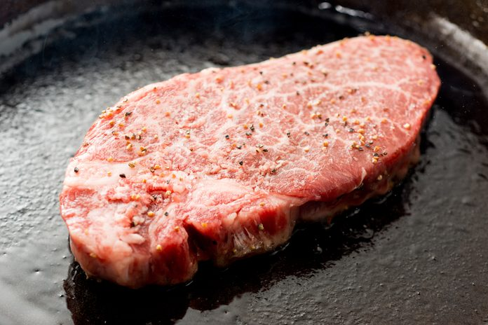 Japanese steak on cast-iron skillet; Shutterstock ID 713192269; Job (TFH, TOH, RD, BNB, CWM, CM): TOH Cast Iron Steak on the Grill