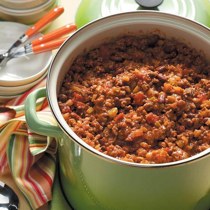 A green pot full of chili.