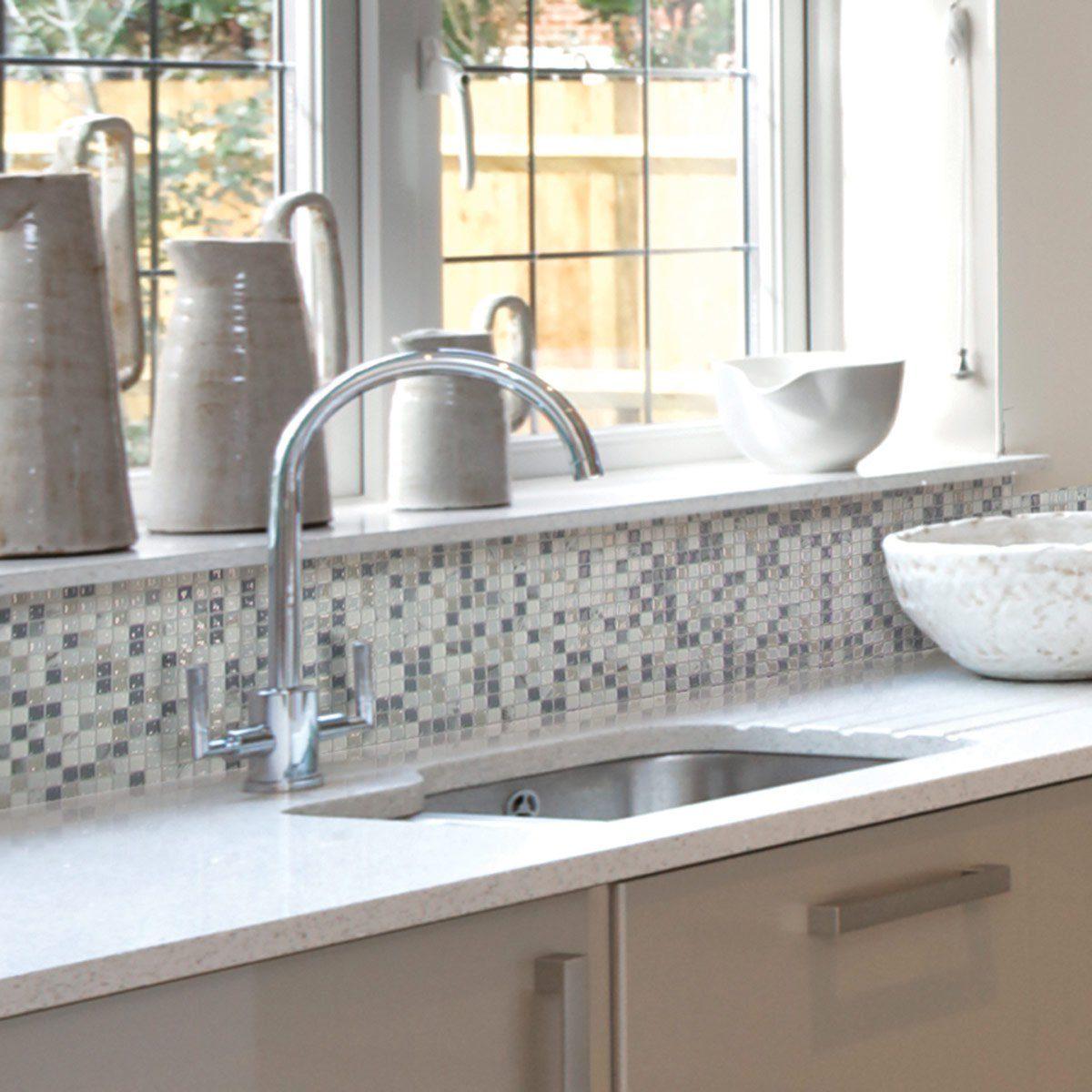 Kitchen with sticker tiles as its backsplash