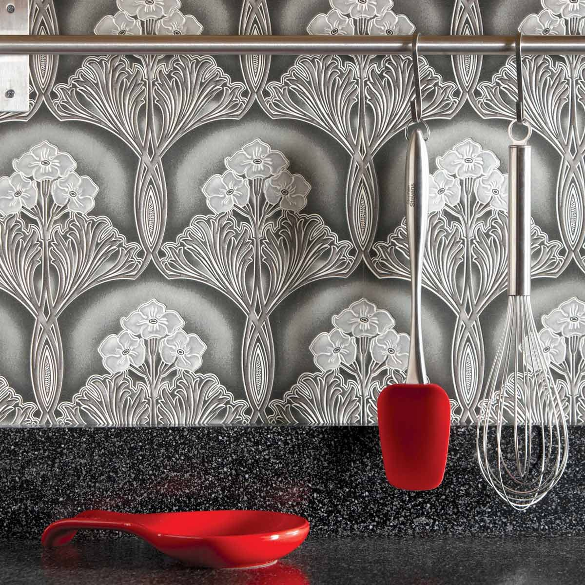 Kitchen with a grey, patterned wallpaper as its backsplash