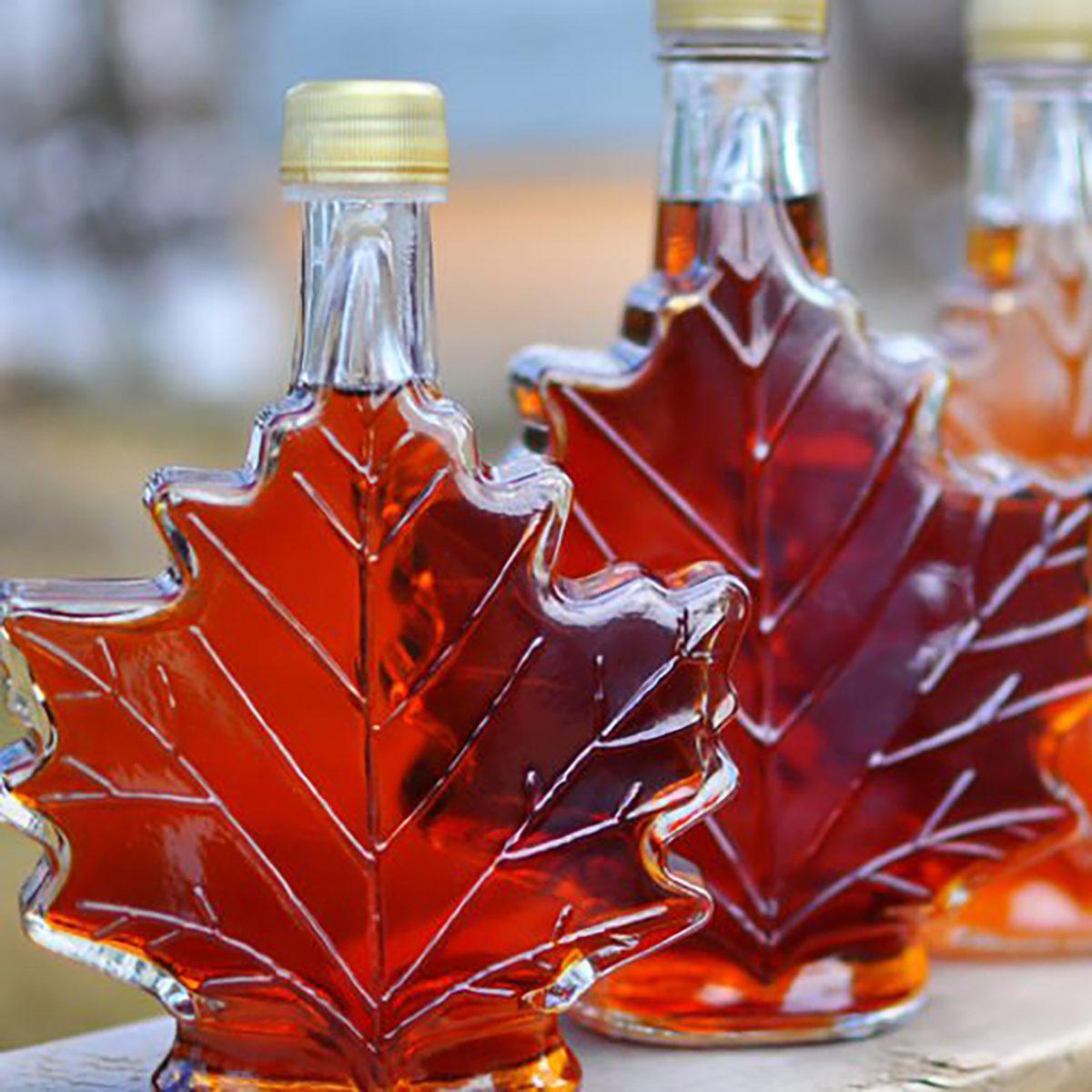 bottles of maple syrup in leaf-shaped bottles