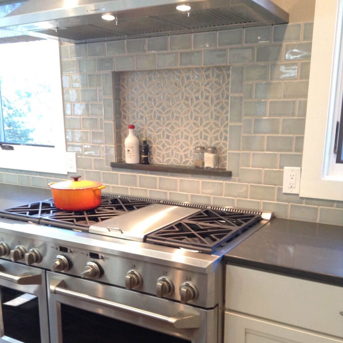 Monochromatic grey tile backsplash