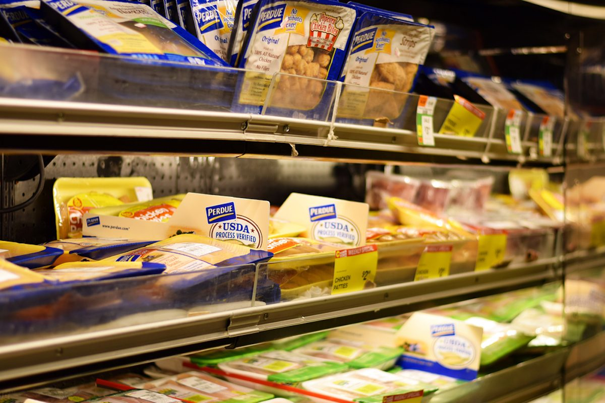 NEW YORK, NY - 11 SEPTEMBER 2016: Plastic wrapped Perdue chicken products in a grocery store;
