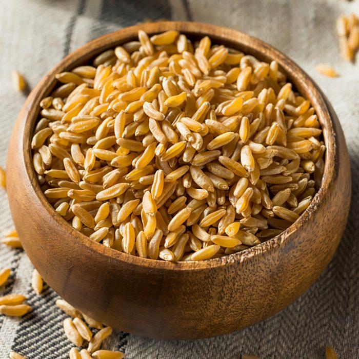Raw Organic Dry Kamut Berries Grain in a Bowl;