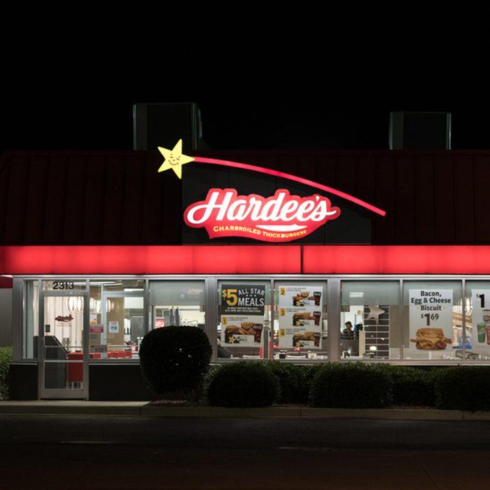 A Hardee's restaurant location at night.