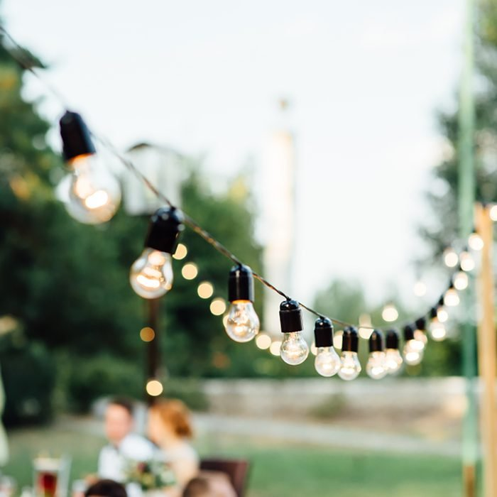 Light bulb decor in outdoor party