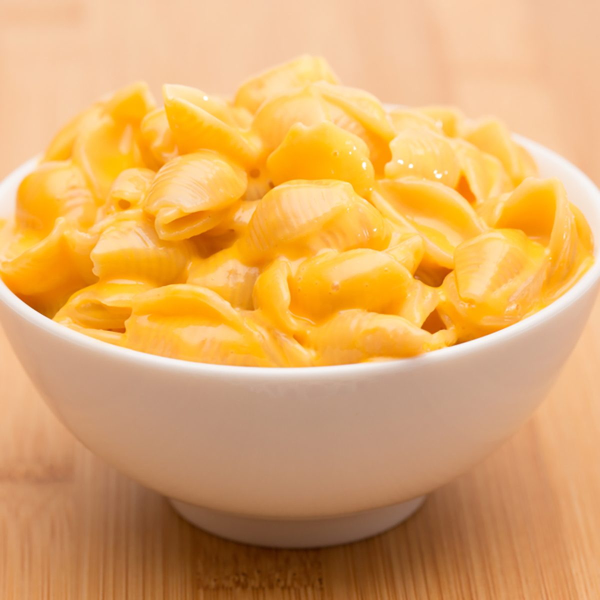 Macaroni Shells and Cheese on a Wooden Table