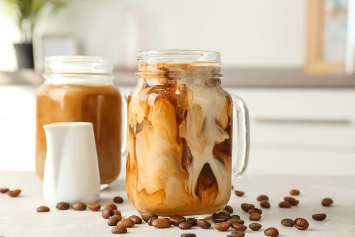 Mason jar with cold brew coffee on table